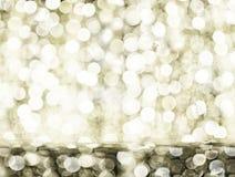 Роскошная золотая предпосылка bokeh светов рождества Размещение продукта стоковое фото