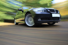 Роскошная спортивная машина в быстром приводе Стоковые Фото