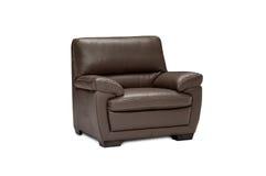 Роскошное кожаное коричневое кресло изолированное на белой предпосылке Стоковые Фото