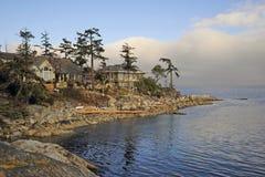 Роскошные дома на береге моря Стоковые Изображения