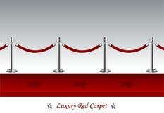 Роскошный красный ковер с веревочкой барьера Стоковая Фотография RF