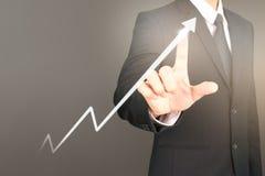 Рост диаграммы плана бизнесмена и увеличение диаграммы положительного ind Стоковая Фотография