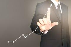 Рост диаграммы плана бизнесмена и увеличение диаграммы положительного ind Стоковое фото RF