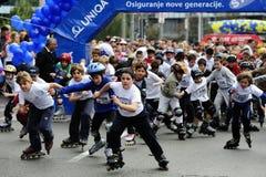 Ролики езды детей на гонке Белграда Rollerskates Стоковые Фотографии RF