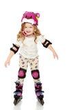 Ролик-коньки маленькой девочки стоковые фотографии rf