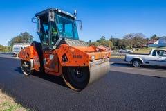 Ролик машины асфальта дороги отделывая поверхность Стоковые Фото