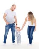родители младенца первые шаги Стоковое фото RF