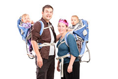 Родители представляя с их младенцами Стоковые Фото