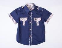 рубашка или рубашка детей на предпосылке Стоковые Фото