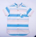 рубашка или рубашка детей на предпосылке Стоковая Фотография