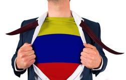 Рубашка отверстия бизнесмена для того чтобы показать флаг Колумбии Стоковые Фото