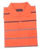 Рубашка. рубашка поло людей сложенная на предпосылке Стоковые Изображения RF