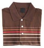 Рубашка рубашка поло людей сложенная на предпосылке Стоковые Фото