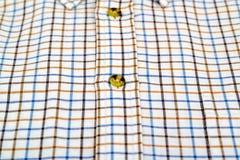 Рубашка Tattersall изолированная на белизне Стоковая Фотография