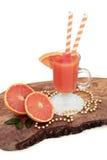 Рубиновое красное питье сока грейпфрута Стоковая Фотография