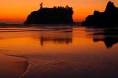 Рубиновый пляж на заходе солнца Стоковое Фото