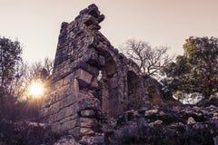 Руины городка Termessos на заходе солнца в Турции Стоковые Фотографии RF