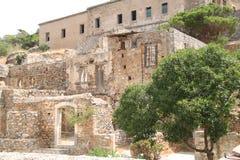 Руины домов, крепость колонии Leper Spinalonga, Elounda, Крит Стоковое Фото