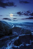 Руины замка в горе на ноче Стоковая Фотография RF