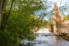 Руины электростанции на реке стоковое фото rf