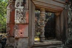 Руины Angkor Wat в джунглях Стоковая Фотография