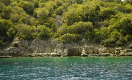 Руины Seashore на острове St Nicholas - острове Gemiler, Турции Стоковое Изображение