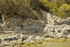 Руины Seashore на острове St Nicholas - острове Gemiler, Турции стоковые изображения