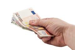 Рука давая деньги изолированные на белой предпосылке Стоковые Изображения RF