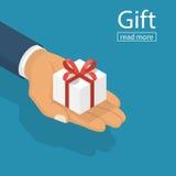 Рука белой коробки подарка равновеликая бесплатная иллюстрация