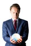 Рука бизнесмена держа земный глобус Стоковая Фотография