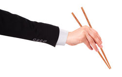 Рука бизнесмена держа палочки стоковая фотография rf