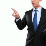 Рука бизнесмена нажимая виртуальный экран стоковая фотография rf