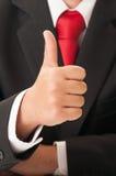 Рука бизнесмена показывая ОДОБРЕННЫЙ знак Стоковые Изображения