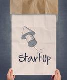 Рука бизнесмена показывая плакат начинает вверх значок Стоковые Изображения