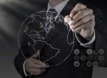 Рука бизнесмена рисуя абстрактный глобус Стоковые Фотографии RF