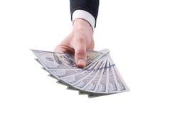 Рука бизнесмена с деньгами Стоковые Фотографии RF