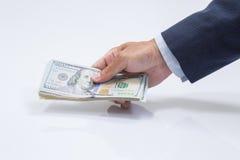 Рука бизнесмена хватая USD Стоковая Фотография RF