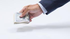 Рука бизнесмена хватая USD Стоковые Изображения RF