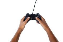 Рука видеоигры женщины играя против белой предпосылки Стоковое Фото