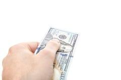 Рука вне 100 примечаний доллара Стоковая Фотография