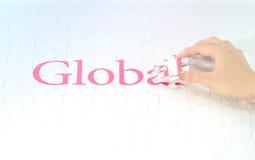 Рука врезает пропускание части глобального слова стоковая фотография