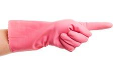 Рука в выставках розовых отечественных перчатки Стоковое фото RF