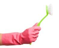 Рука в розовой щетке удерживания перчатки Стоковое Изображение RF