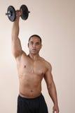 рука гантели поднимая один вес тренера Стоковая Фотография RF