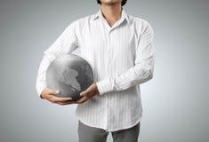 рука глобуса земли накаляя Стоковое фото RF