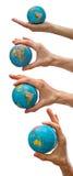 рука глобуса Стоковые Фото