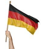 Рука гордо развевая национальный флаг Германии Стоковое Изображение RF