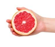 рука грейпфрута половинная Стоковое Фото