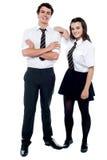 Рука девушки школы отдыхая на ее однокласснике Стоковые Фотографии RF