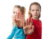 рука делая знак остановить twogirls Стоковое Изображение